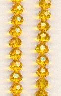 5mm Faceted Topaz Glass Beads